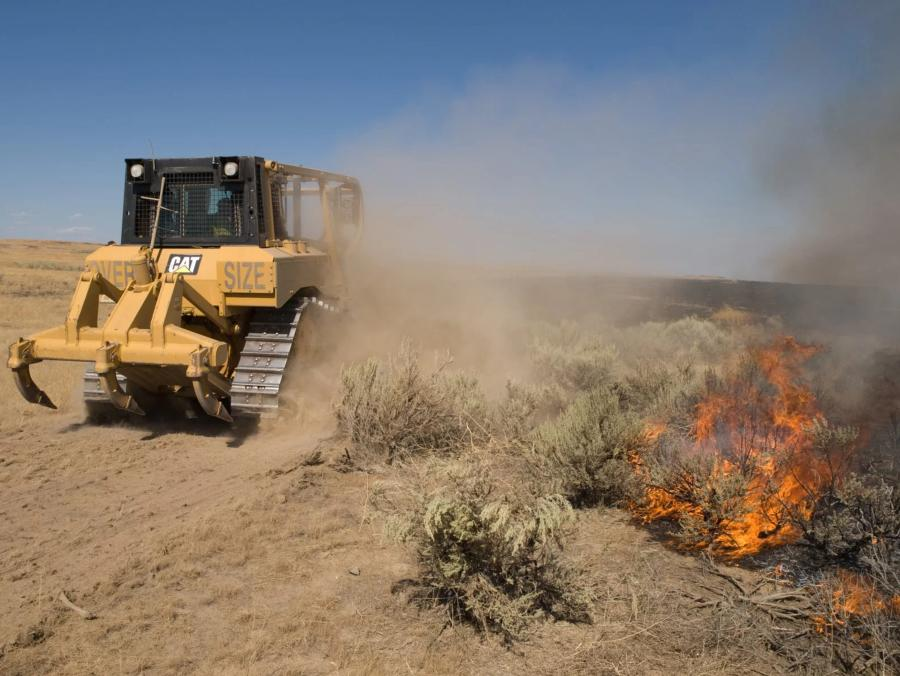 Fire districts often own their heavy equipment but also rent additional pieces during the fire season. (National Interagency Fire Center photo)