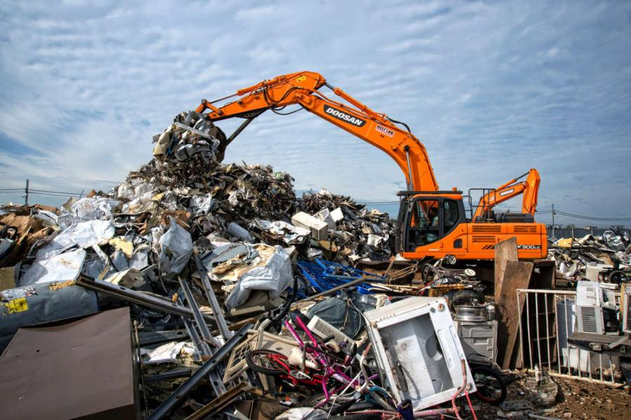 The DX300LC-3 has the power to handle substantial loads of scrap metal.