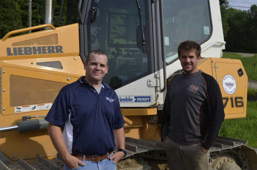 Travis Marshall (L), Tracey Road Equipment sales representative, and Sam Beisler, president of Foothills Sustainable Forestry, with the Liebherr model 716 crawler dozer.