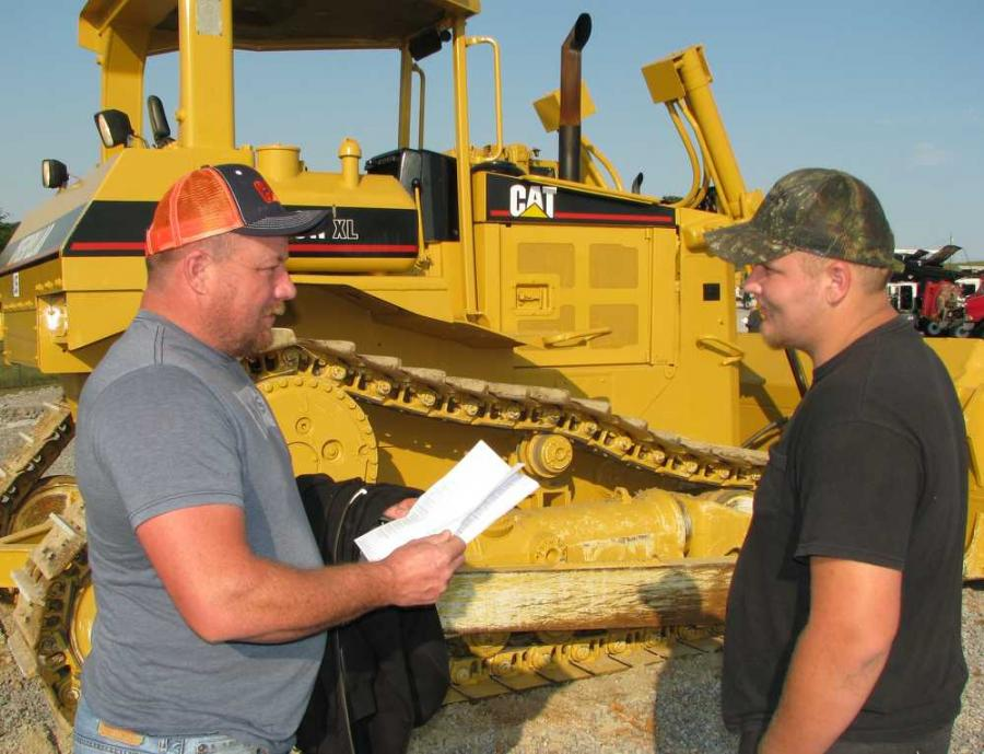 Looking over a Cat D6R XL dozer are Jason Sanders (L) and Trent Sanders of Sanders Hauling in Pineville, Ky.