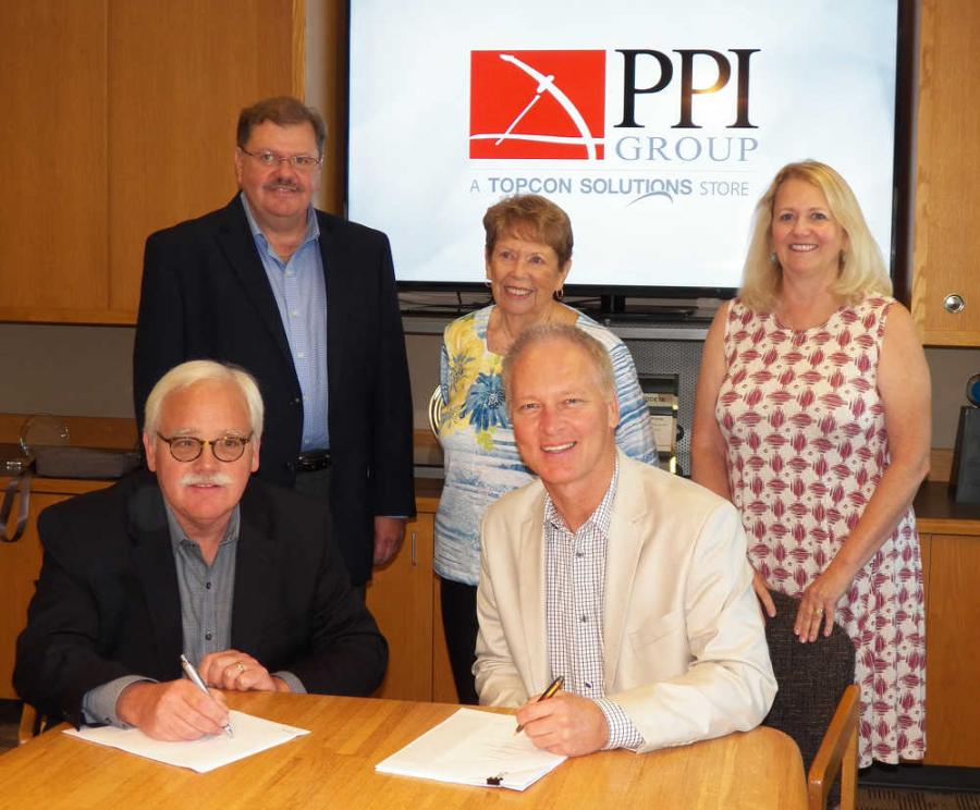 (Clockwise from lower R) Jamie Williamson of Topcon; Tigue Howe, Jeff Peterson, Joan Peterson and Jean Howe of PPI Group during the signing event.