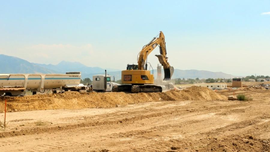 Crews grade and excavate the new ramp for 9000 South.