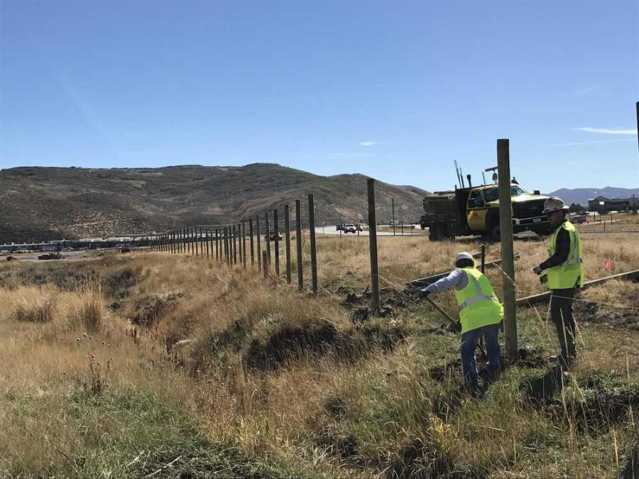 UDOT crews install wildlife fencing. 