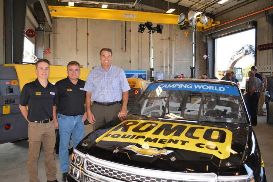 Bob Mullins (R), president of ROMCO Equipment, joins John Hunter Nemecek (L), driver of the ROMCO Chevrolet Silverado in the NASCAR Camping World Series, and Joe Nemecek, owner of NEMCO Motorsports. ROMCO sponsors the truck in both appearances at Texas Motor Speedway.