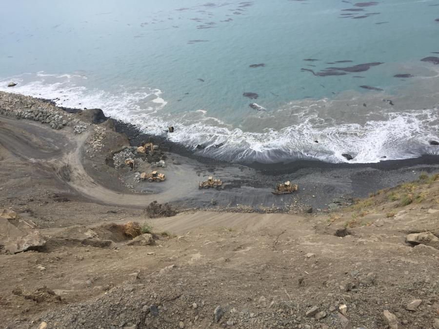 The new road will cross over the landslide material. Bulldozers and compactors will create a sturdy roadway surface atop the material. (Caltrans photo)