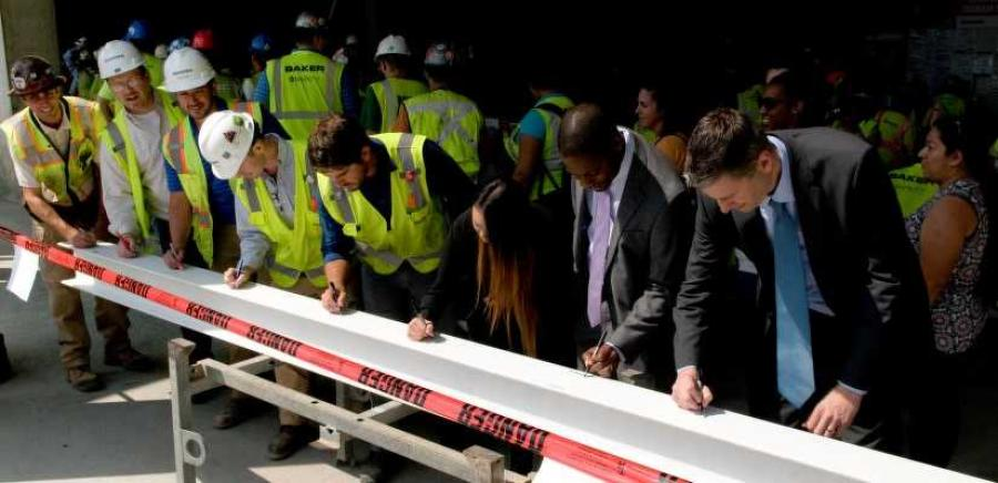 The D.C. team signs the final beam at the topping out of 99M Street.
