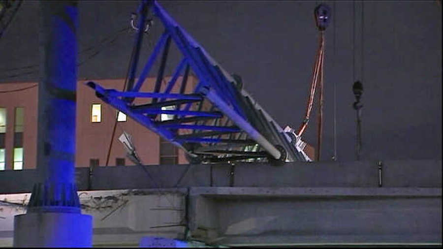 Officials say a large beam fell onto Interstate 4 in Florida, Oct. 3, as crews were removing it, shutting down traffic in both directions.