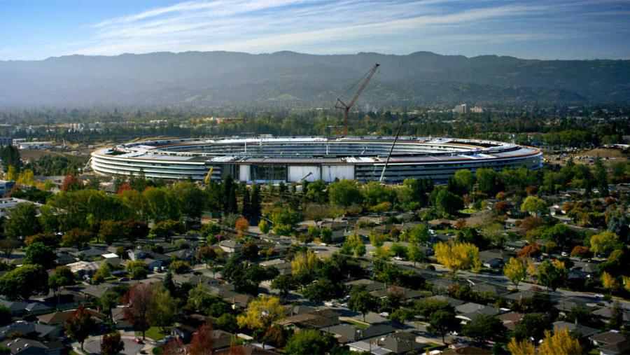 Apple's main, 2.8-million-sq.-ft. building will hold up to 12,000 employees. The donut-shaped facility boasts a 1-mile circumference and over 8,200 parking spots.