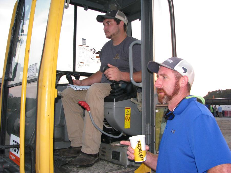 Cliff Gracen (L) and Aaron McFarlane, both of Hydraulic Repair Services, Savannah, Ga., test operate a Volvo ECR88 compact excavator.