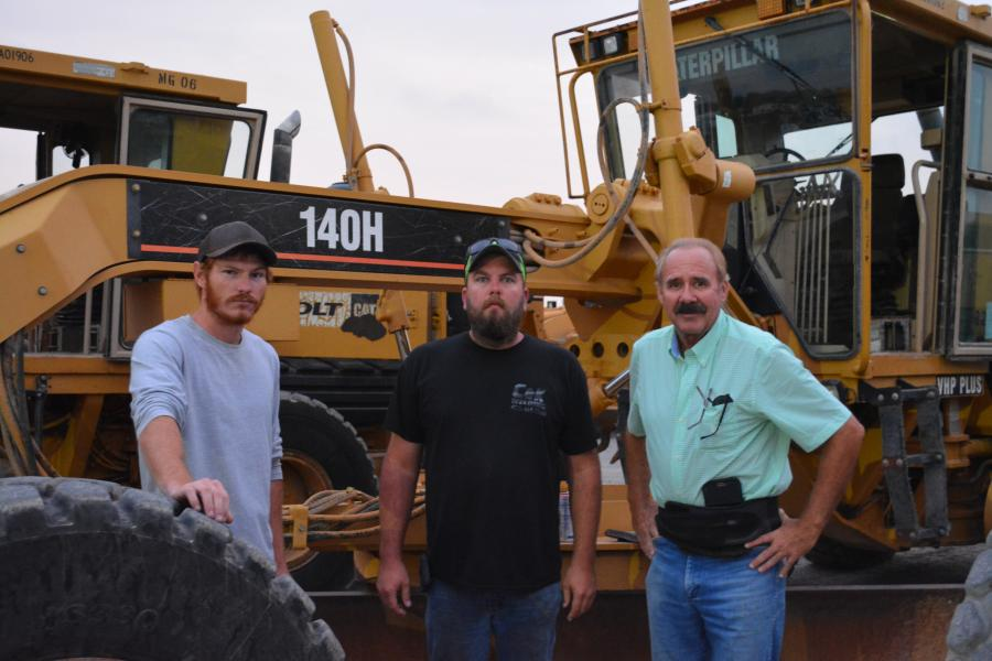 (L-R): Dakota Johnson of Granite Excavation and Construction; Tyler Frankhouser and Byron Coates of Circle C Excavating were on hand from Oklahoma to buy excavators and graders. They put the Cat 140H through its paces early in the morning on auction day.