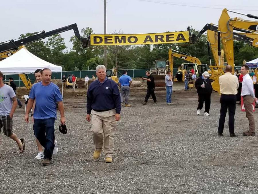 Bill Allen of Allen Industries and Jim Smith, H.O. Penn sales representative, head to the food tent after spending some quality time in the demo area.