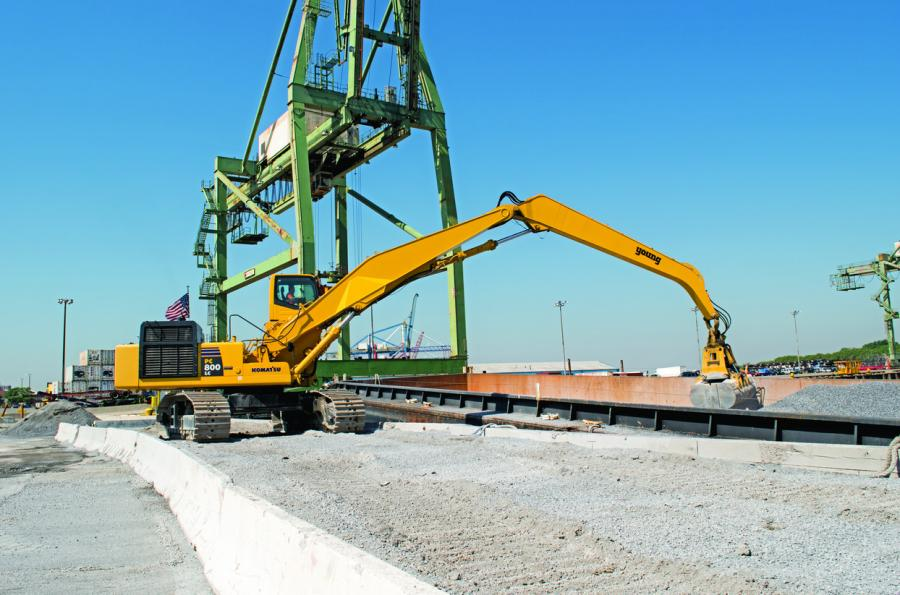 This Divine Management operator uses the company's Komatsu PC800LC-8 excavator to unload a barge at its Brooklyn location. The company outfitted the excavator with an extended boom, a clamshell bucket and an extended cab to maximize efficiency and visibility when unloading material from barges.