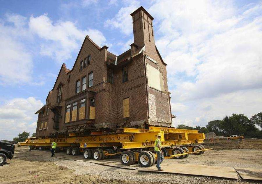 Moving a 120-year-old historic mansion in one piece can be a precarious job.