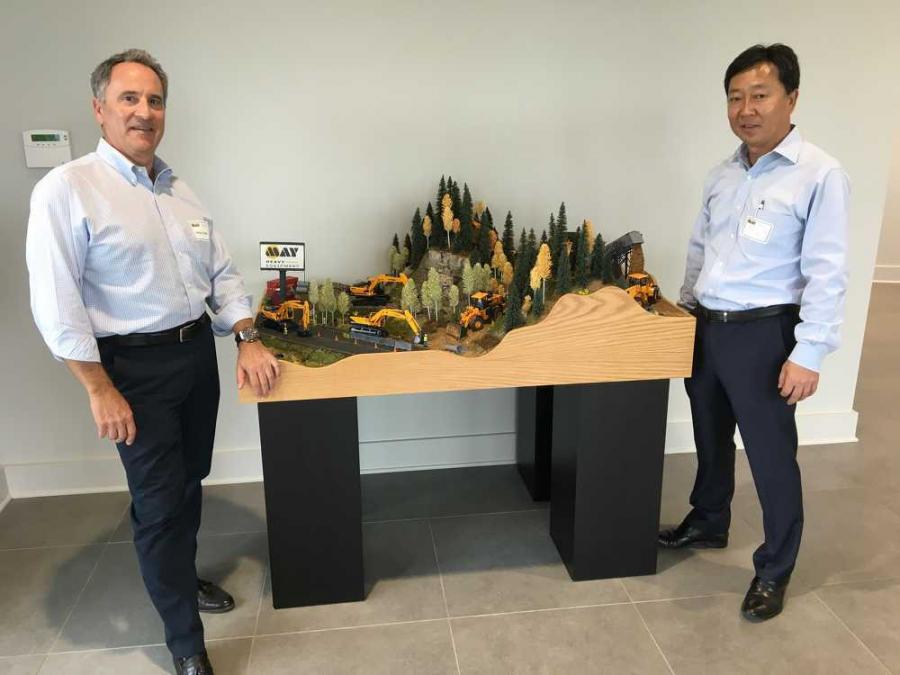 Kerry Vickar (L), chairman and CEO of May Heavy Equipment, accepts the hand-crafted construction site created by Hyundai, which was presented by M.S. Kang, president and CEO of Hyundai Construction Equipment Americas Inc.