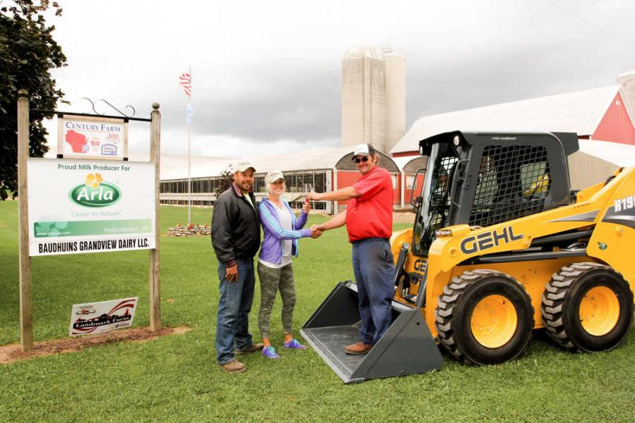 Luxemburg Motor Company delivers Gehl R190 to Baudhuin Dairy Farm. From left: Rob Baudhuin, Tammy Baudhuin and Dean Massart.