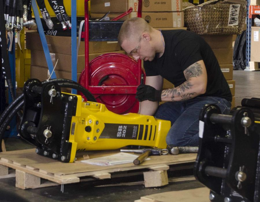 """Stacy said another advantage of the Competency Center is its 18 employees. """"Everyone that works in this facility works specifically with hydraulic attachments, all the way down to parts and supplies."""