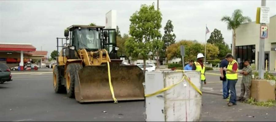 The Caterpillar wheel loader was tied to a company in Vista, Calif., according to officers on the scene. The 950K model weighs almost 20,000 pounds.