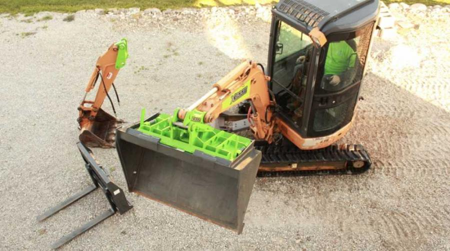 The XBoom system utilizes a universal skid steer adapter attached to the boom-end of the host machine.