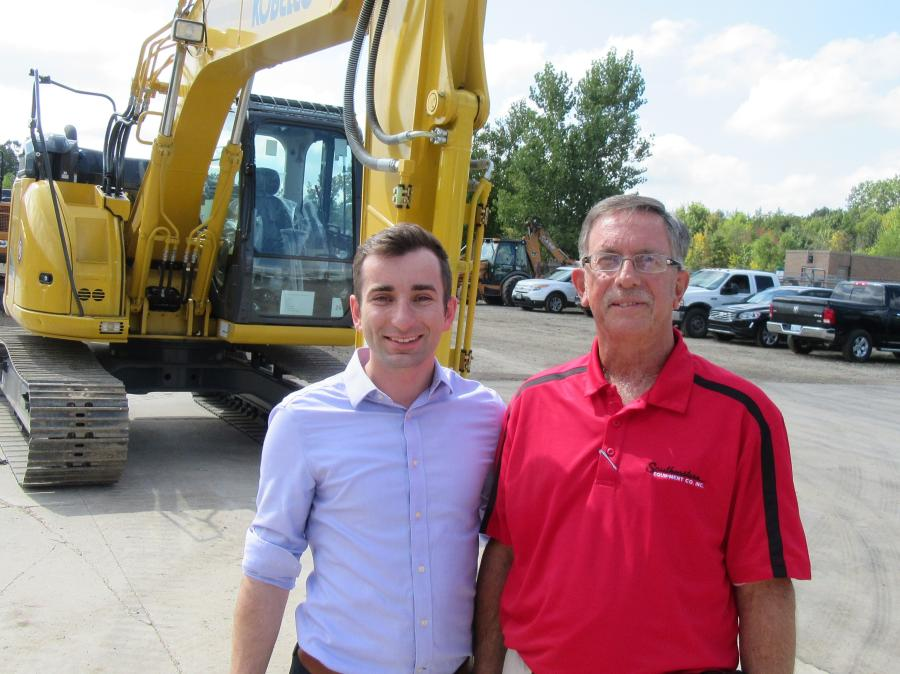 Thor Hess (L), Southeastern Equipment Company executive vice president, joins Dennis Kemeny, sales representative, to welcome visitors to the Novi, Mich., branch.