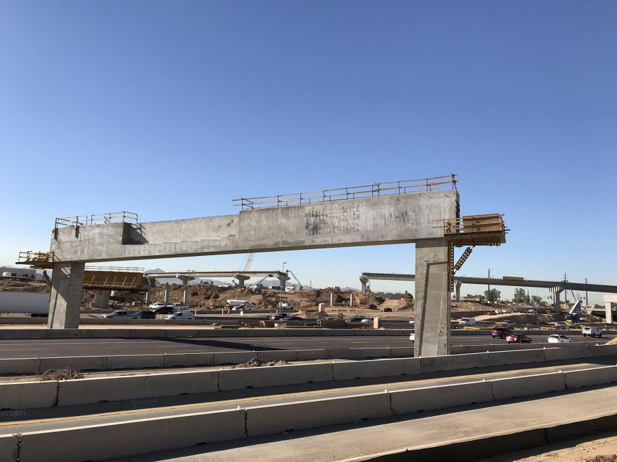 The first girders are in place more than six stories above I-10 for a flyover ramp that will carry South Mountain Freeway traffic to westbound I-10.
