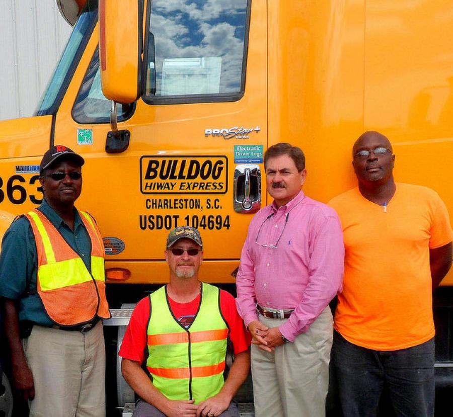 With Phil Byrd, president of Bulldog Hiway Express, (second from right), are senior drivers,(left to right), Robert Gibbs, Timothy Smith and Gerald Waring.