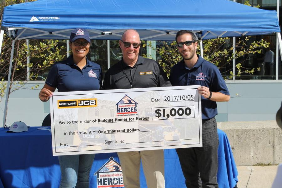 Northland JCB presented Building Homes for Heroes with a $1,000 donation during the event. (L-R): Jazmine Jean-Francois, national sales and sponsorship representative of Building Homes for Heroes; Alan Hammersly, COO of Northland JCB, and David Weingrad, product development and communications executive of Building Homes for Heroes.