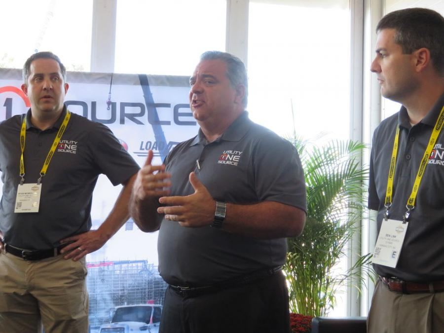 Fred Ross (C), CEO of Utility One Source, addresses the media at its press conference at ICUEE and discusses his company's new initiatives, while Ryan McMonagle (L), COO, and Ben Link, both of Utility One Source, look on.