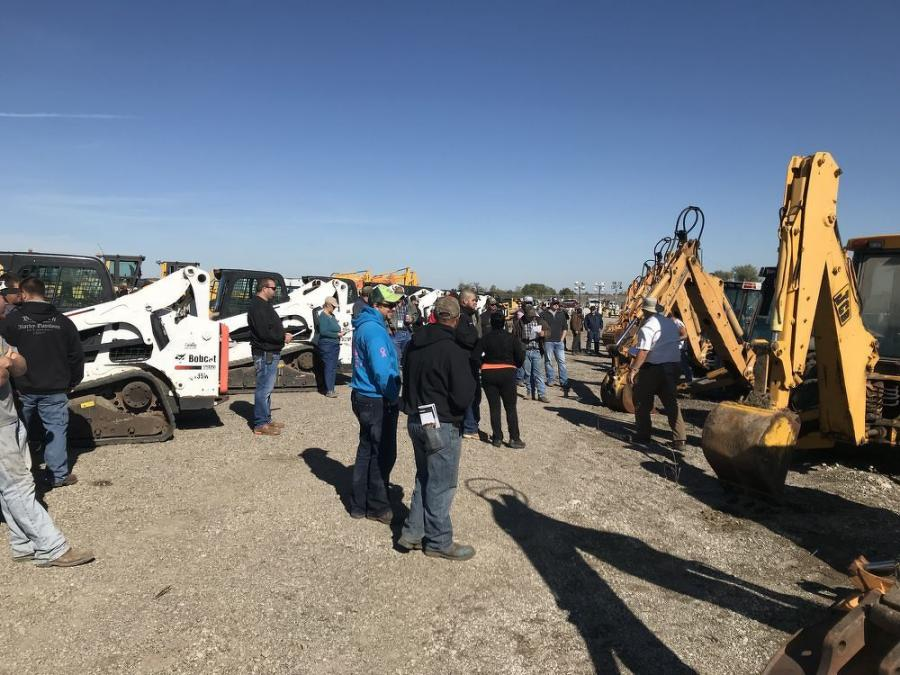 Customers place their bids on the farm and construction equipment.