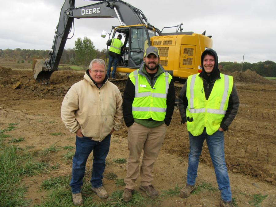 (L-R): Eric McConnell of McConnell Excavating in Oberlin, Ohio, talks with Murphy Tractor & Equipment's Ethan Irish and Chris Schaub, John Deere product consultant, at the demonstration event.