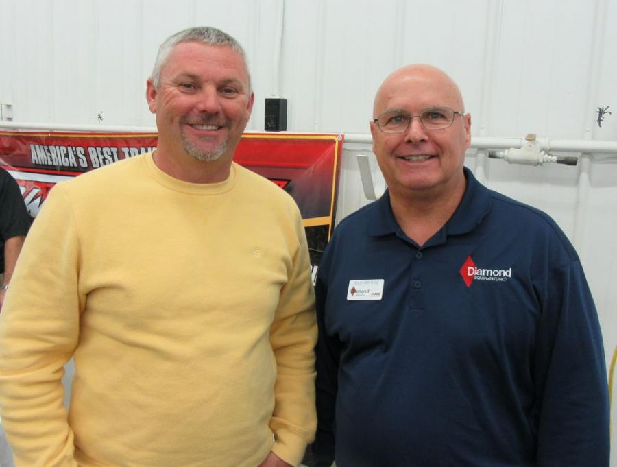 Scott Normington of Ground Control Excavating, talks with Dave Fortune, Diamond Equipment, at the open house event.