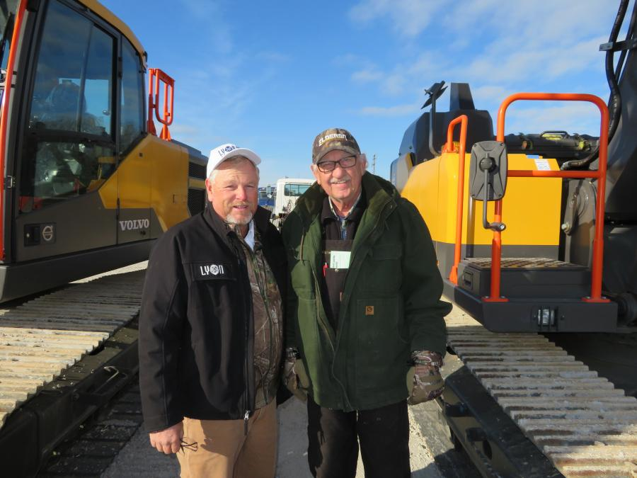 Mike Powers (L), Alex Lyon & Son, points out the excavators available at the sale to Don Schwalbach, president of Elderon Truck and Equipment.