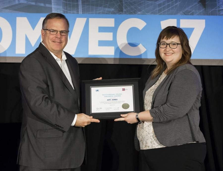 SAE/AEM Outstanding Young Engineer award winner Amy Jones receives plaque from SAE Board of Directors member Landon Sproull of PACCAR Inc. at 2017 SAE COMVEC Awards Luncheon.