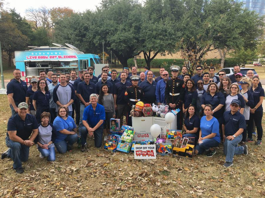 Nearly 80 employees took part in the walk, and the group collected boxes of toys for Toys for Tots.