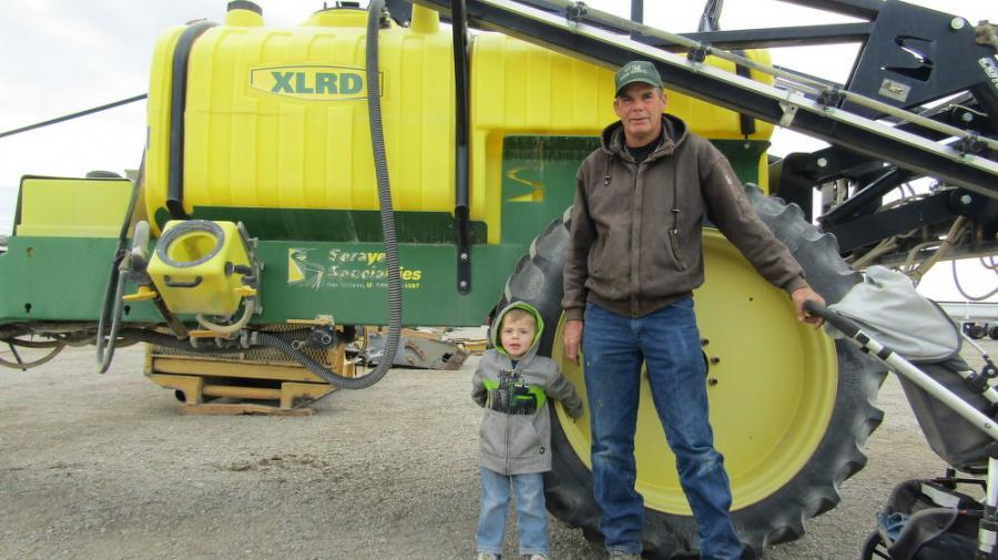 Emerson Lavett (L) and his dad Ralph, of Lewis Construction in Moapa, Nev., spend some quality father-son time together looking to replace some machinery. This XLRD high-clearance sprayer captured their attention.