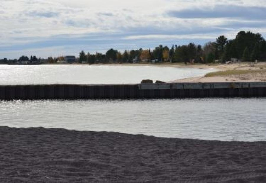 The Department of Natural Resources spent nearly $250,000 this year to dredge 9,000 cu. yds. of sand that was threatening to close off the harbor, but a Lake Superior storm undid much of the work. 