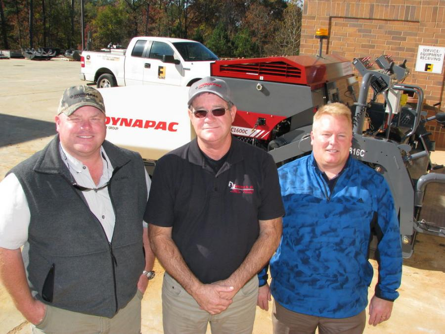 (L-R): Flint Construction & Forestry Division's Phillip Murphey; Gaskins & Co.'s Greg Gaskins; and Dynapac's Joe Seckinger assemble for delivery of the new Dynapac FC1600C.