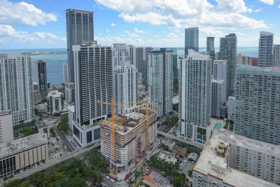 Vertical construction of Brickell Flatiron, a 64-story luxury condominium tower now rising in Miami's Brickell Financial District, has surpassed the building's 17th floor pedestal.