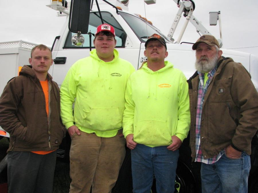 (L-R): Richard Gill and three generations of the Godfrey family, Mark, Kevin and Charlie Godfrey, all of Godfrey Tree Service, Summerville, Ga., are pleased with the deal they got on a 55-ft. Altec bucket truck.