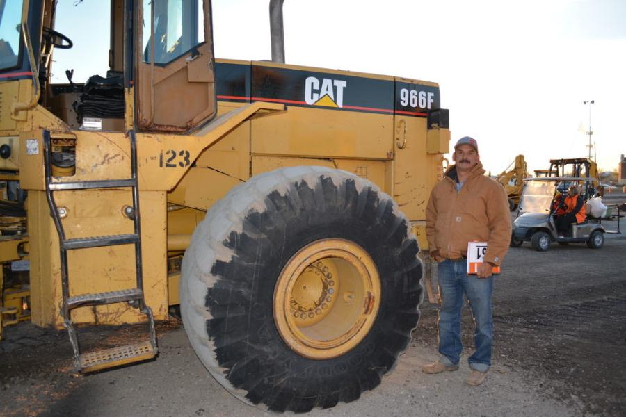 The Cat 966F loader has the attention of Victor Garzarelli of Left Lane Trucking, Marion, Texas.