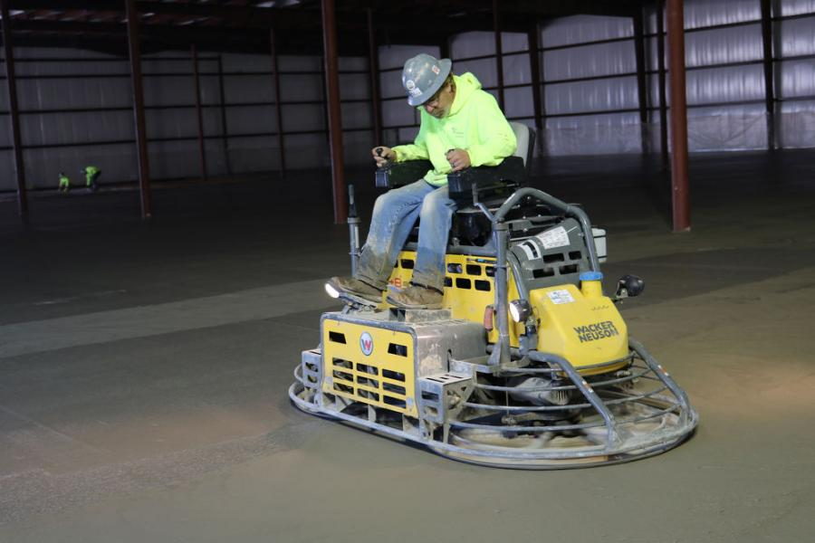 The first trowel on the slab was Wacker Neuson's CRT48-57K-PS hydro-electric power steer trowel, which is dedicated to the initial panning process.