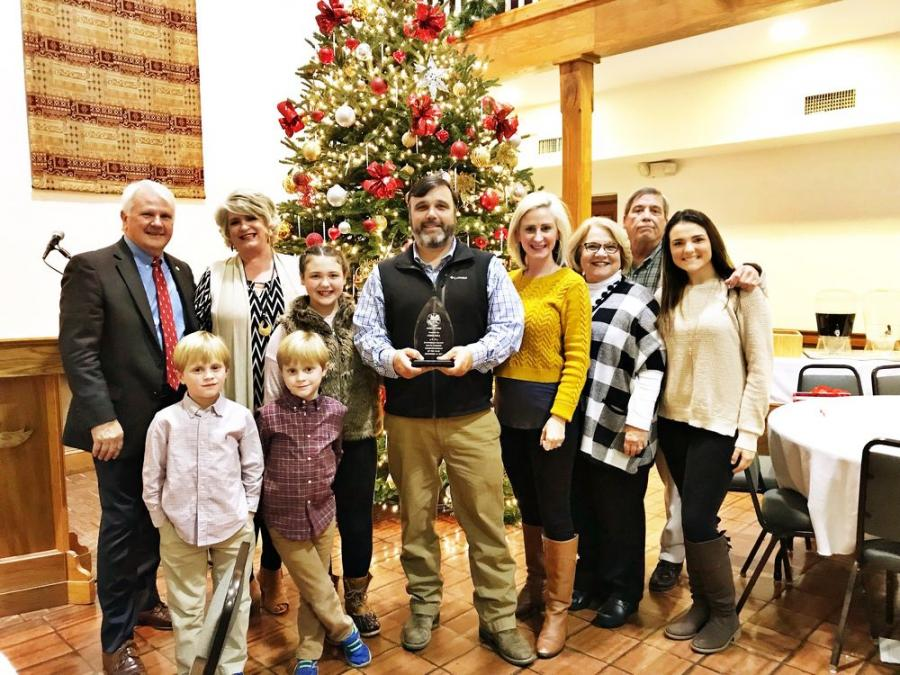 Chris and Jessica Shea with their children and parents, along with award presenter, Georgia House Representative Jon Burns at the 2017 Effingham County Young Farmers annual awards banquet.