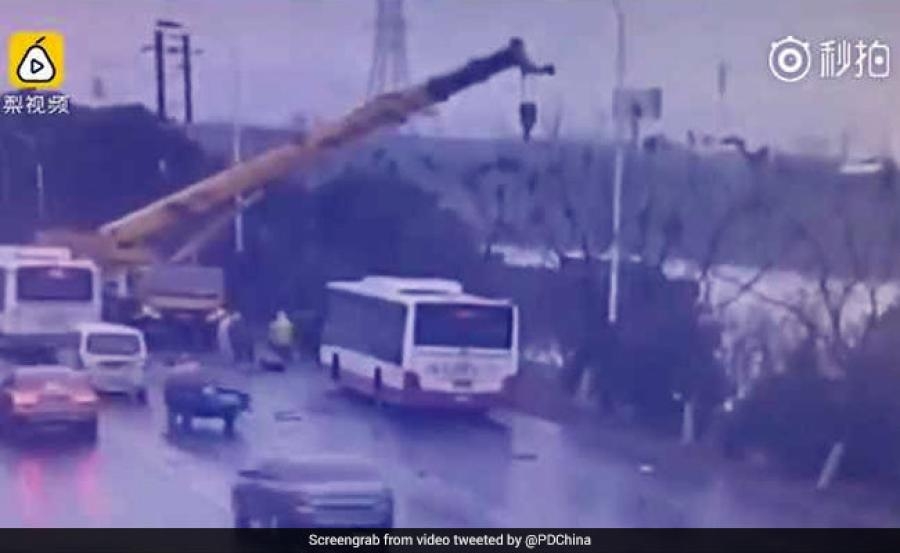 A video, posted by People's Daily, China, shows the crane operator coming down from his crane and running to the crash scene to survey the damage.