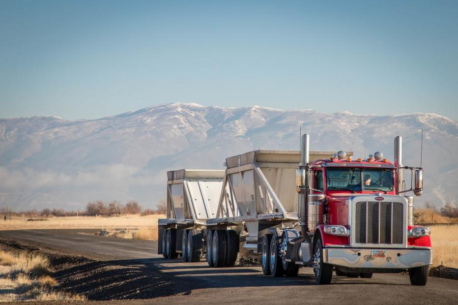 The initial site work will involve an average of 30 double-belly dump and 15 truck and pups hauling an average of 9,000 tons of AIA fill material and 4,000 tons of gravel a day for approximately four months to place the initial fill for the project.  