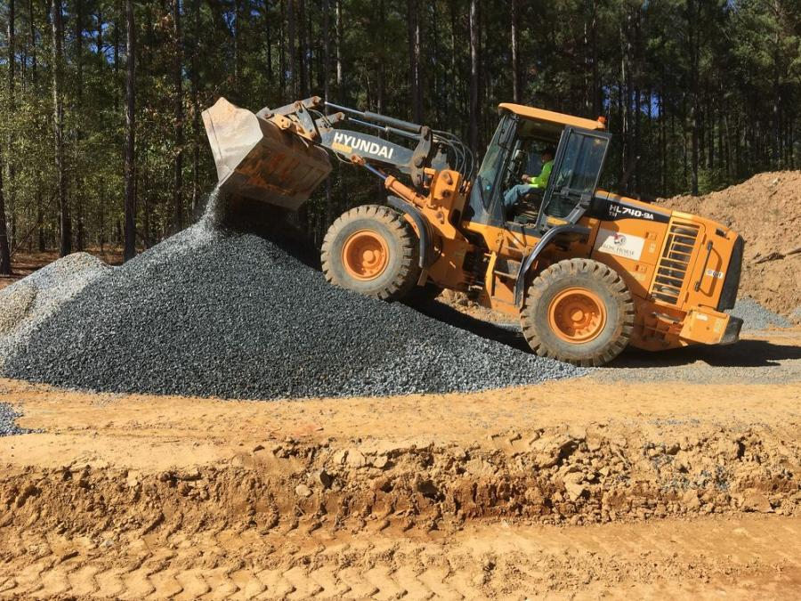 The operator of this Hyundai HL740-9A wheel loader moves stone on site.