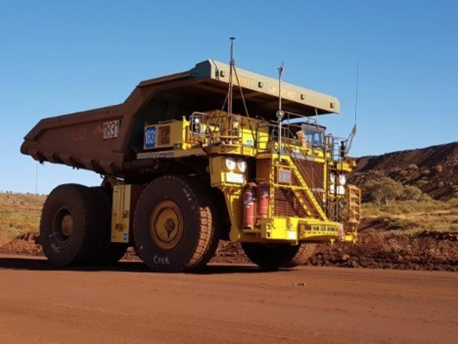 A standard truck 830E with the AHS retrofit kit running in autonomous mode at Rio Tinto's mine in Australia.