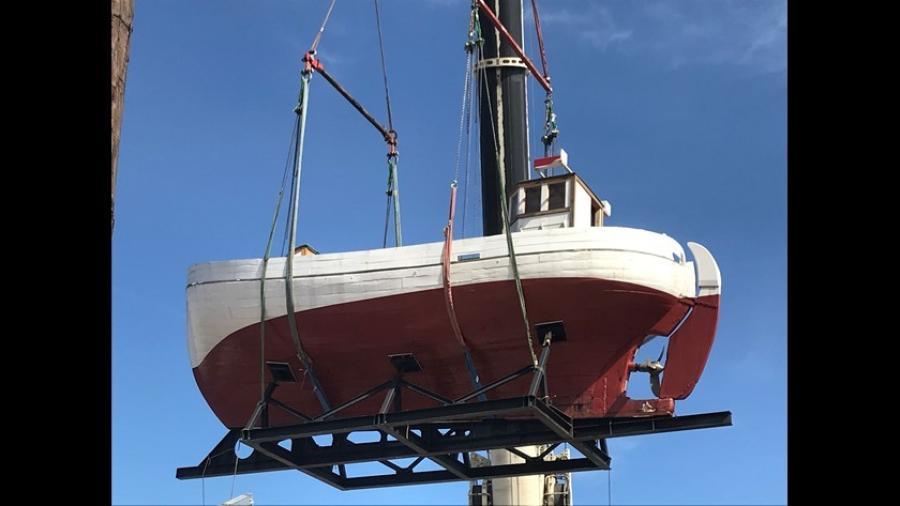 A crane lifts a WWII-era Danish boat. (Photo Credit: KHOU News)