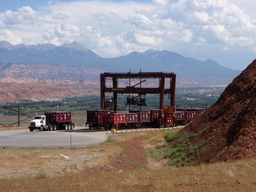 A gantry crane is used on the rail bench to transfer containers to and from the train at the Moab site.