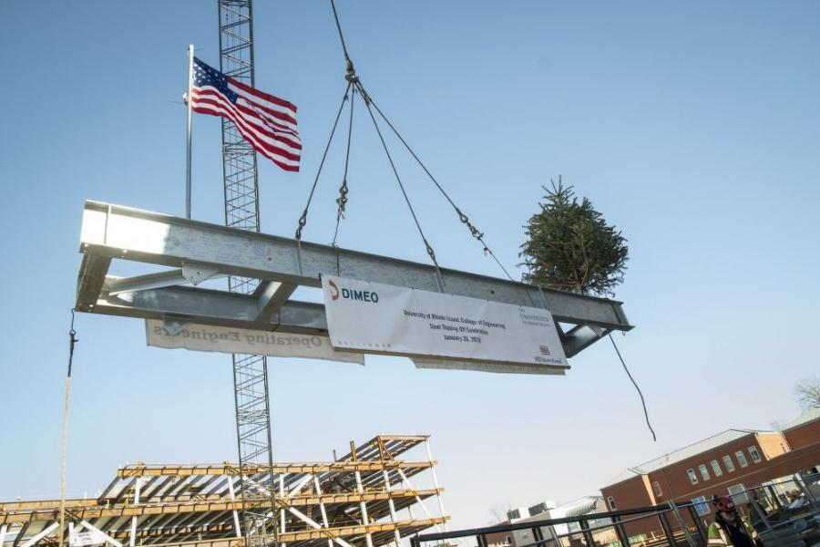 The beam is lifted during the topping out ceremony on Jan. 26 at the new College of Engineering building.