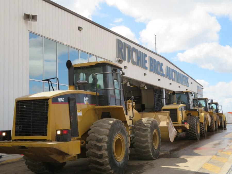 Caterpillar wheel loaders go over the auction ramp at the Ritchie Bros. Orlando auction.