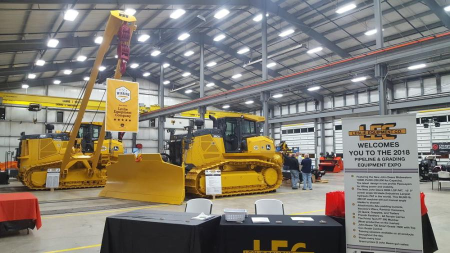 The dealership's shop area was set up as an indoor display area for attendees to visit and discuss specific features and capabilities of the machines.
